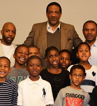 Clyde Mayes with group of children